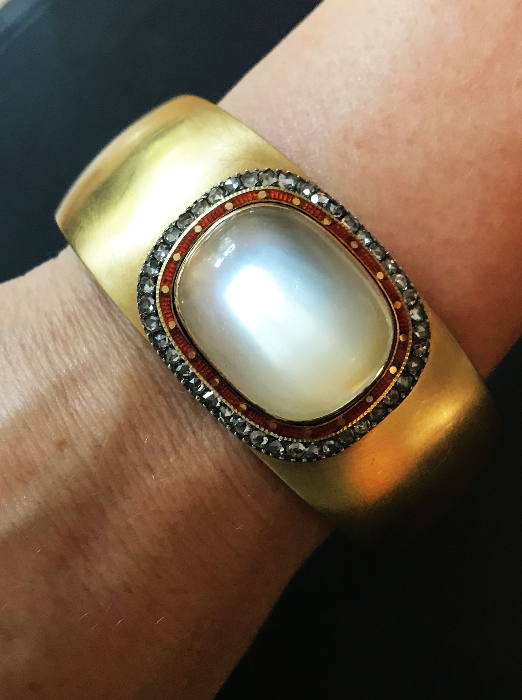 A gold bangle with moonstone & Diamonds