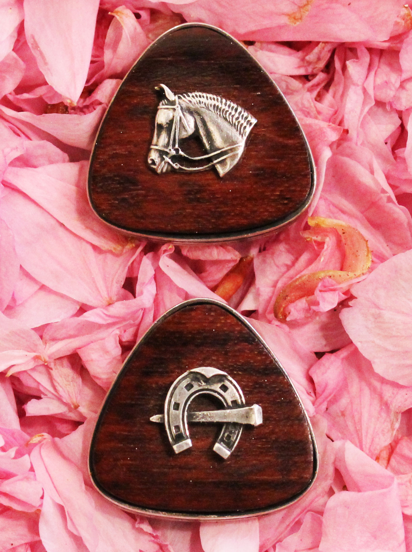 Triangular cufflinks by Victor Mayer with a horse head on rosewood