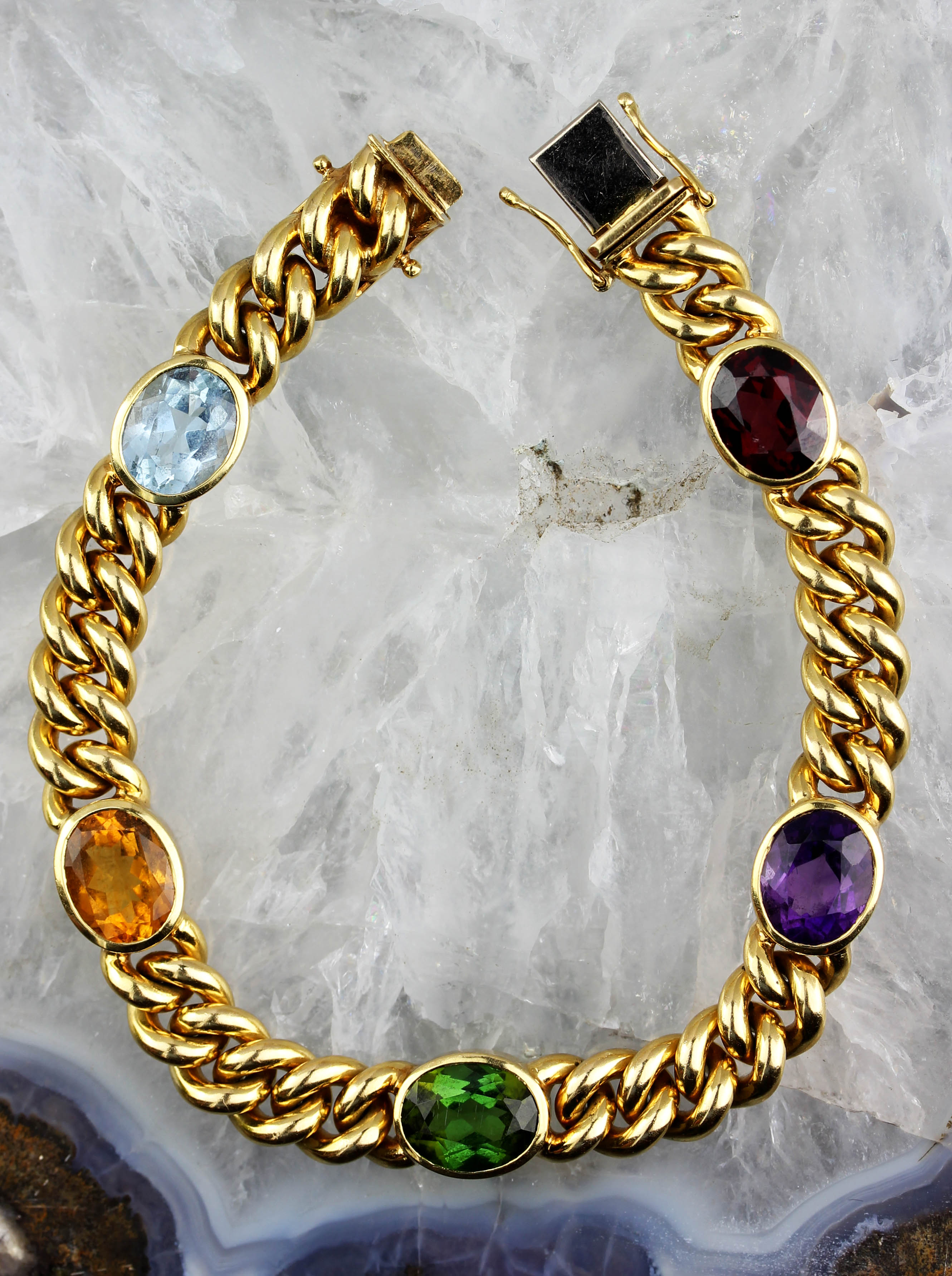 Beautiful gold bracelet with colorful stones