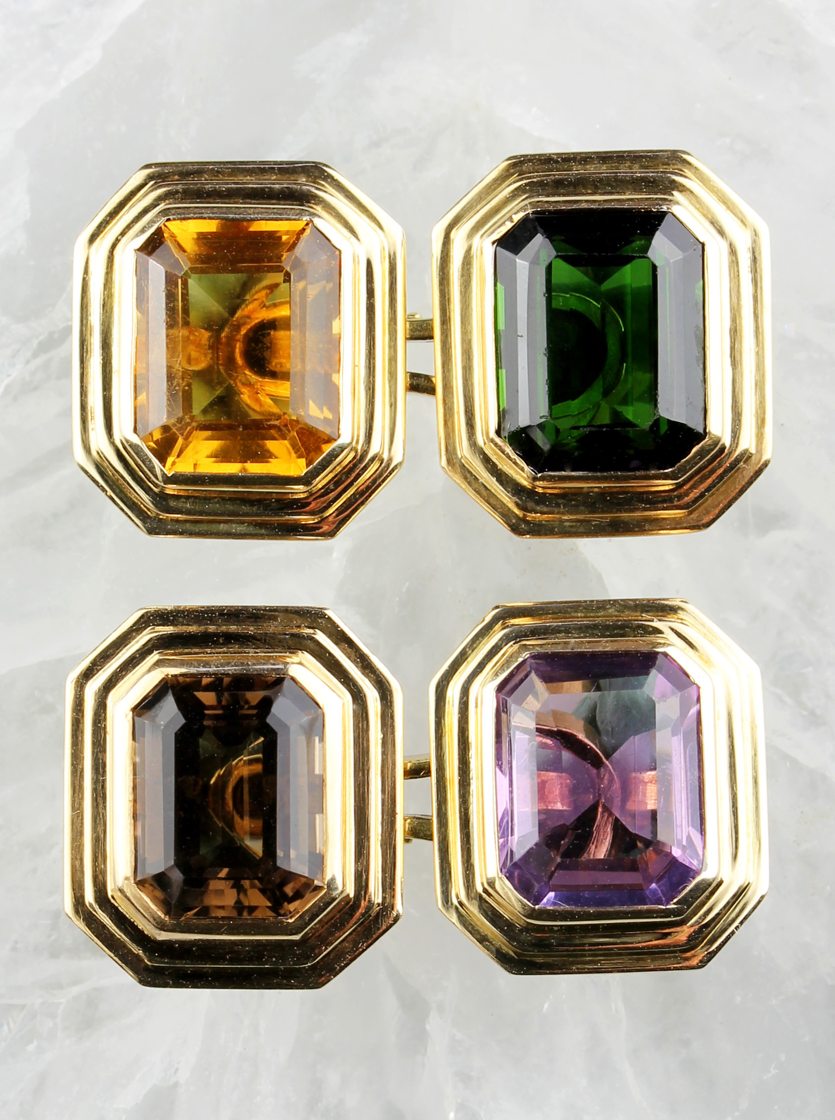 Colorful cufflinks in gold
