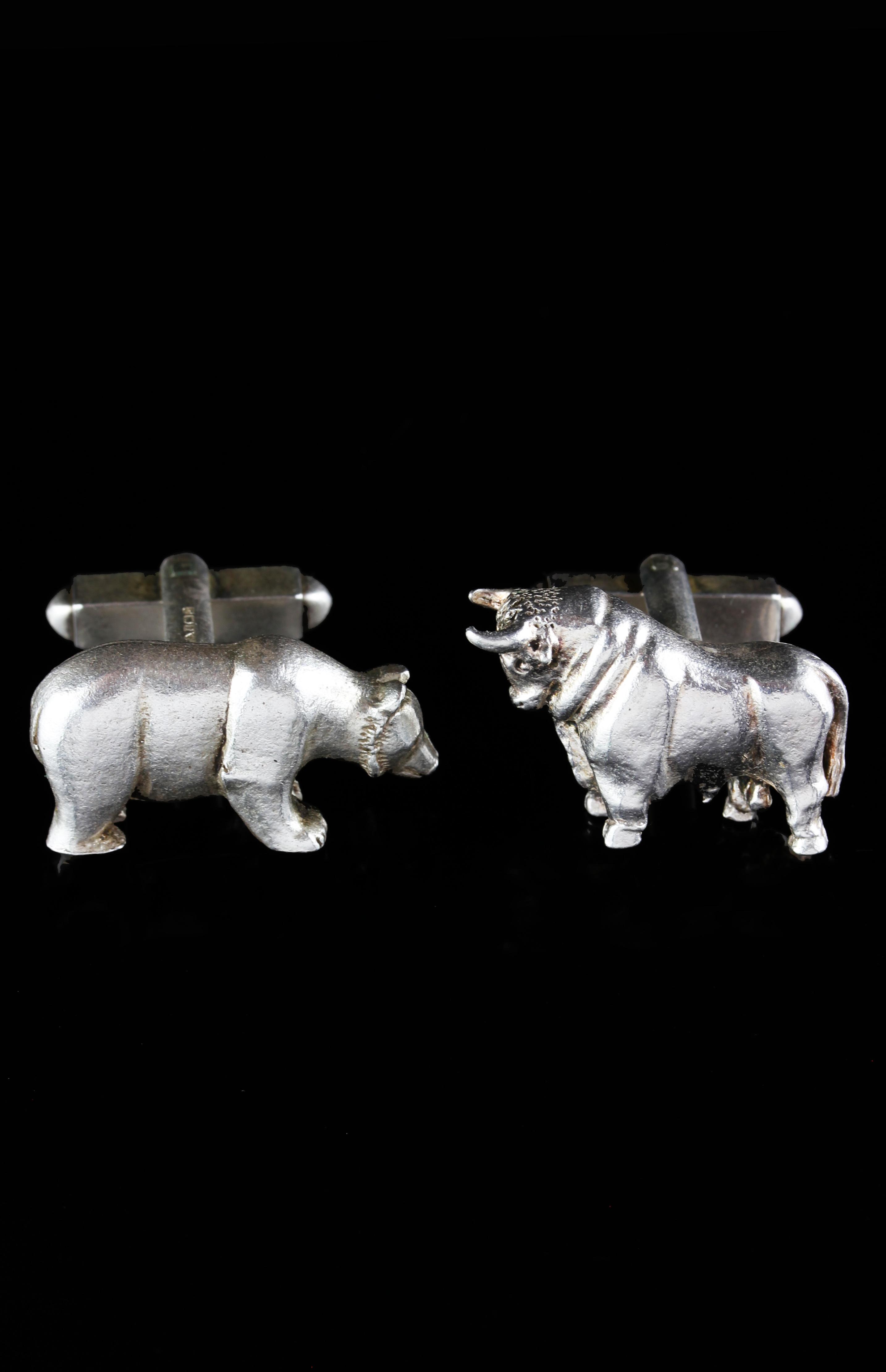Pair of silver cufflinks with bull & bear