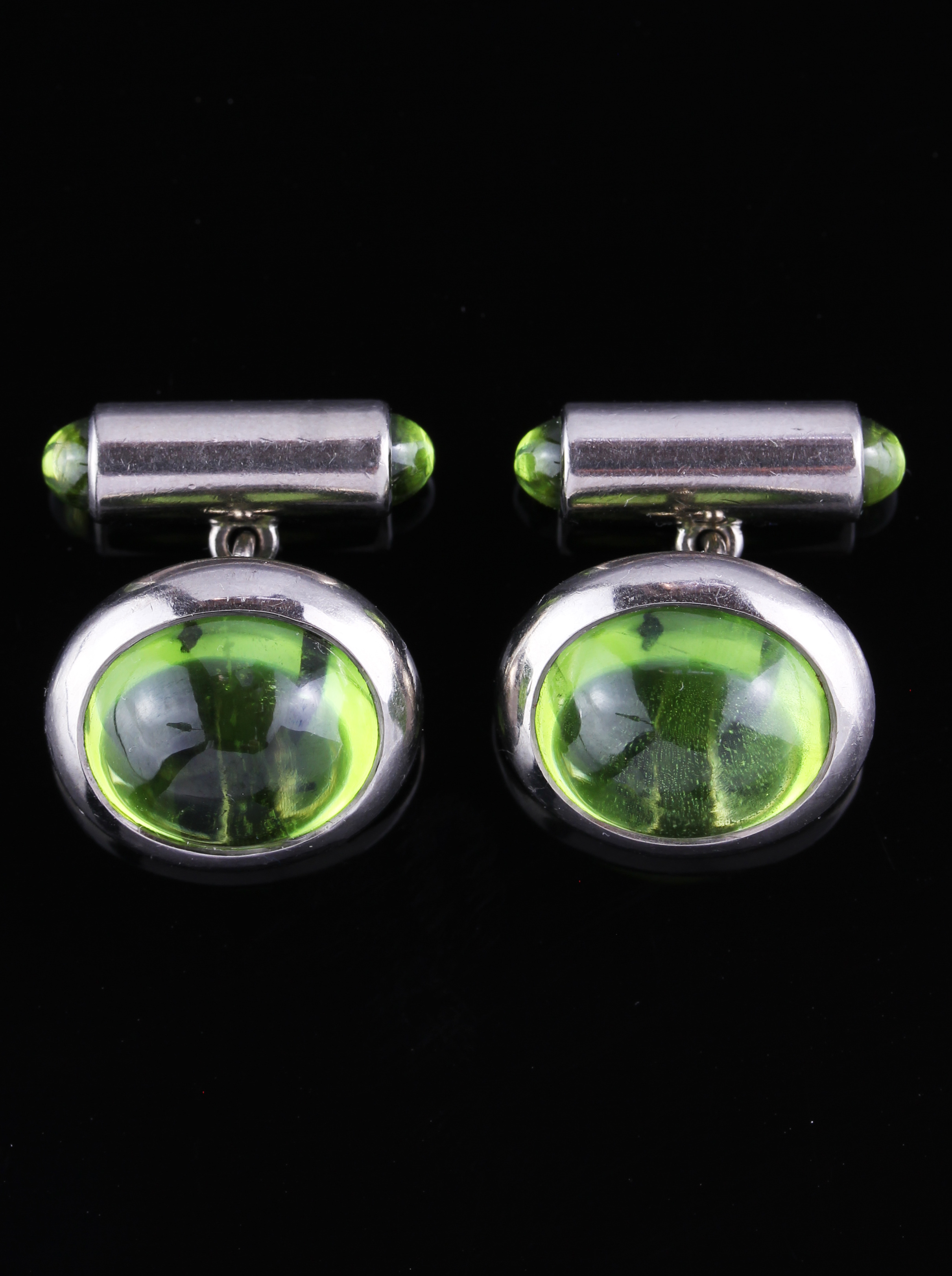 White gold cufflinks with Peridots made by HEMMERLE