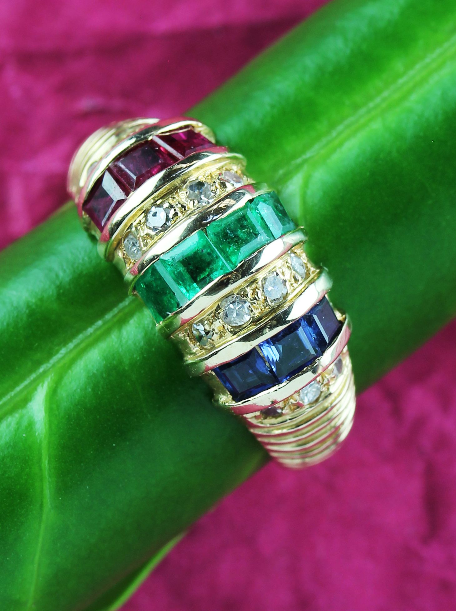 A gold ring with sapphires, emeralds, rubies and diamonds