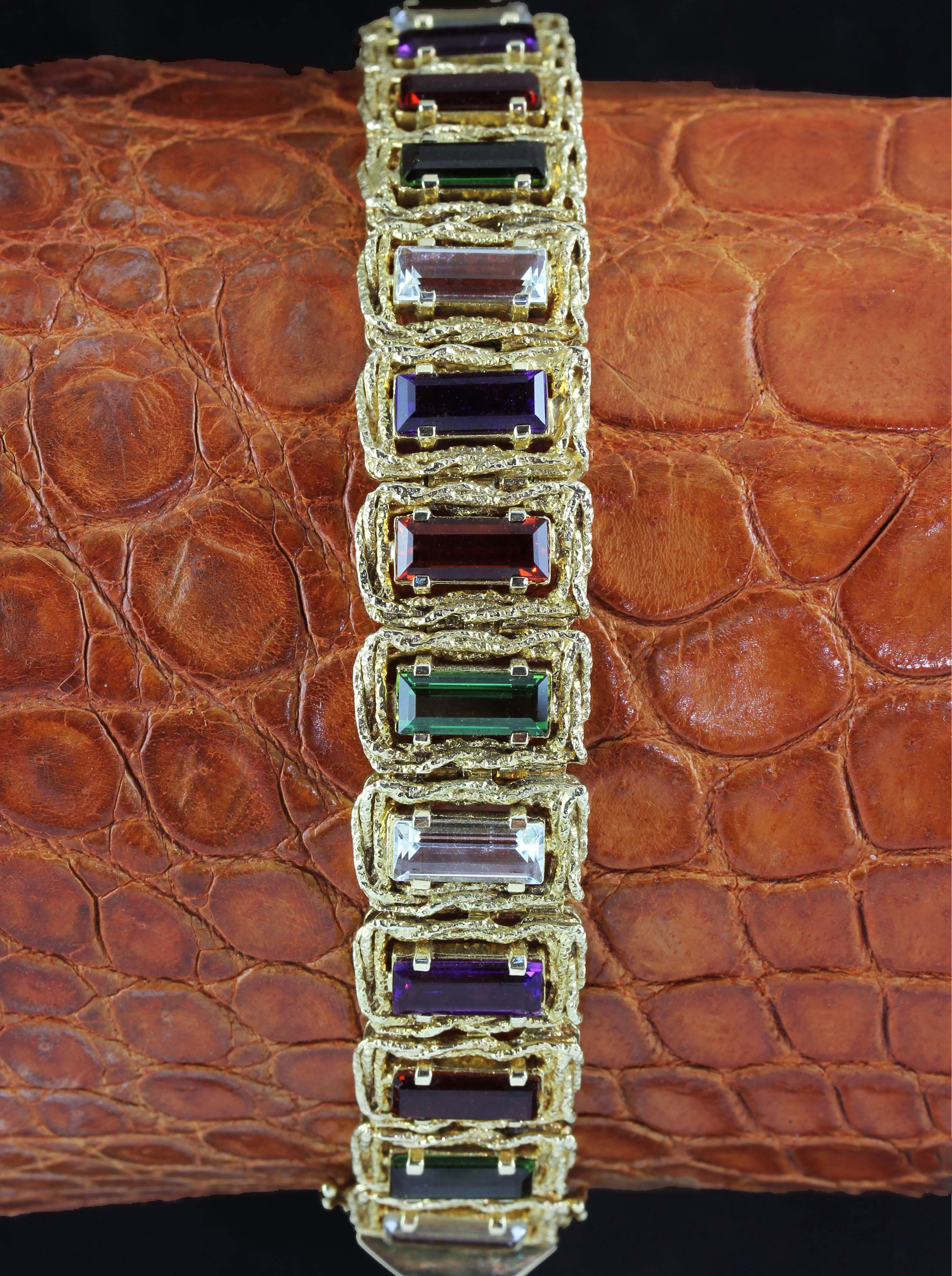 Gold bracelet with several emerald cut gem stones