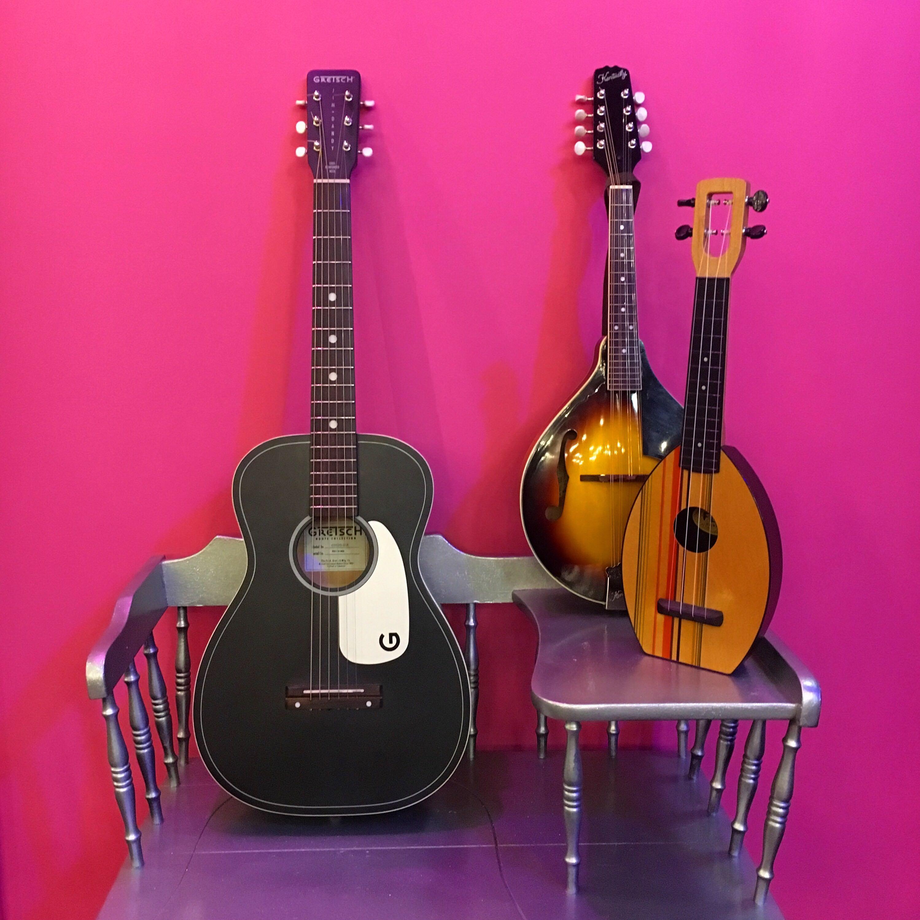 Black acoustic guitar, uke, mandolin
