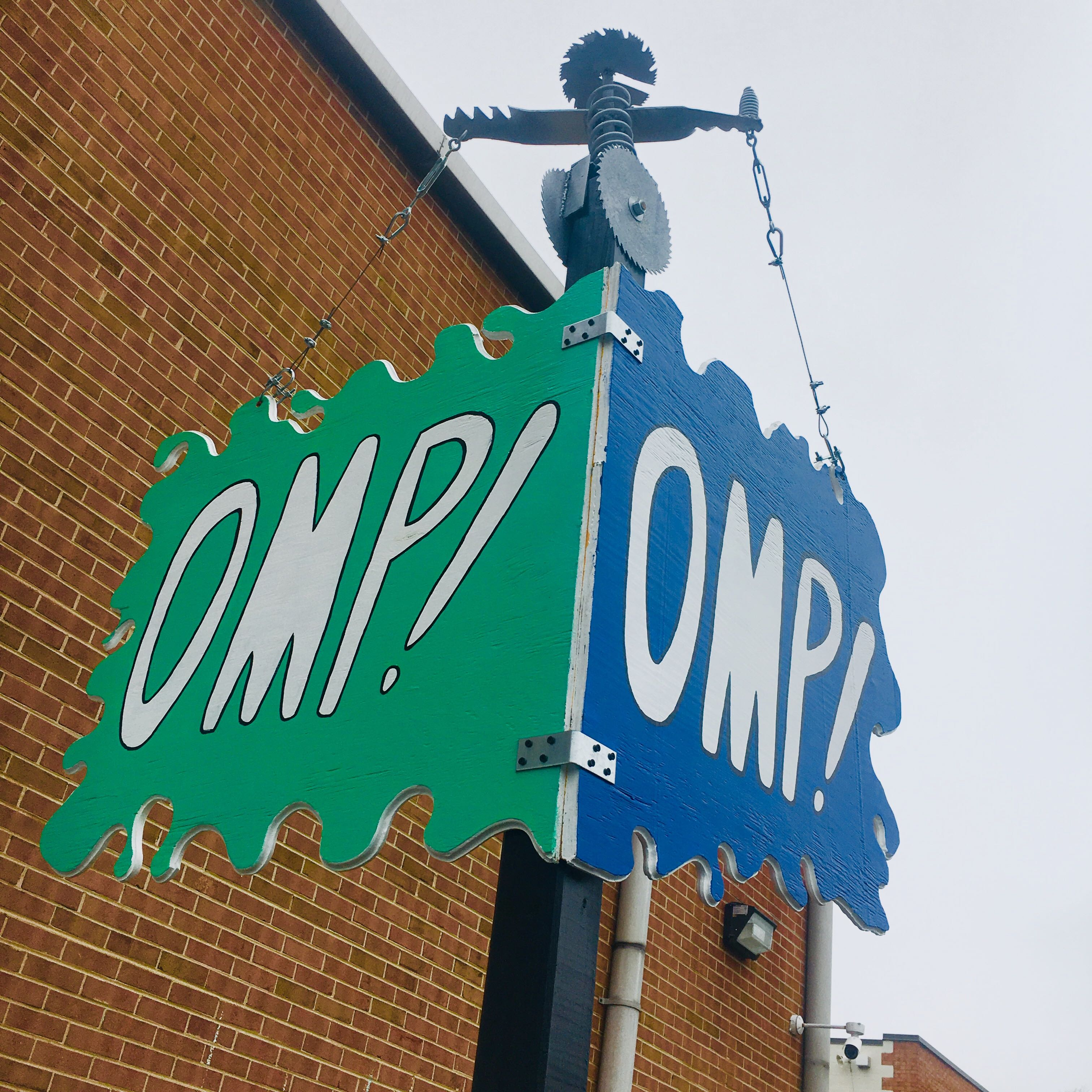 OMP! street signs at the far west side of the warehouse.