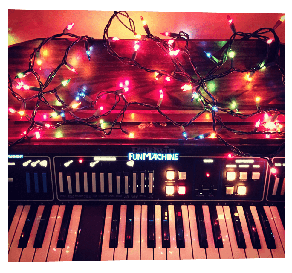 A 1970s vintage Baldwin Fun Machine decorated with Christmas lights