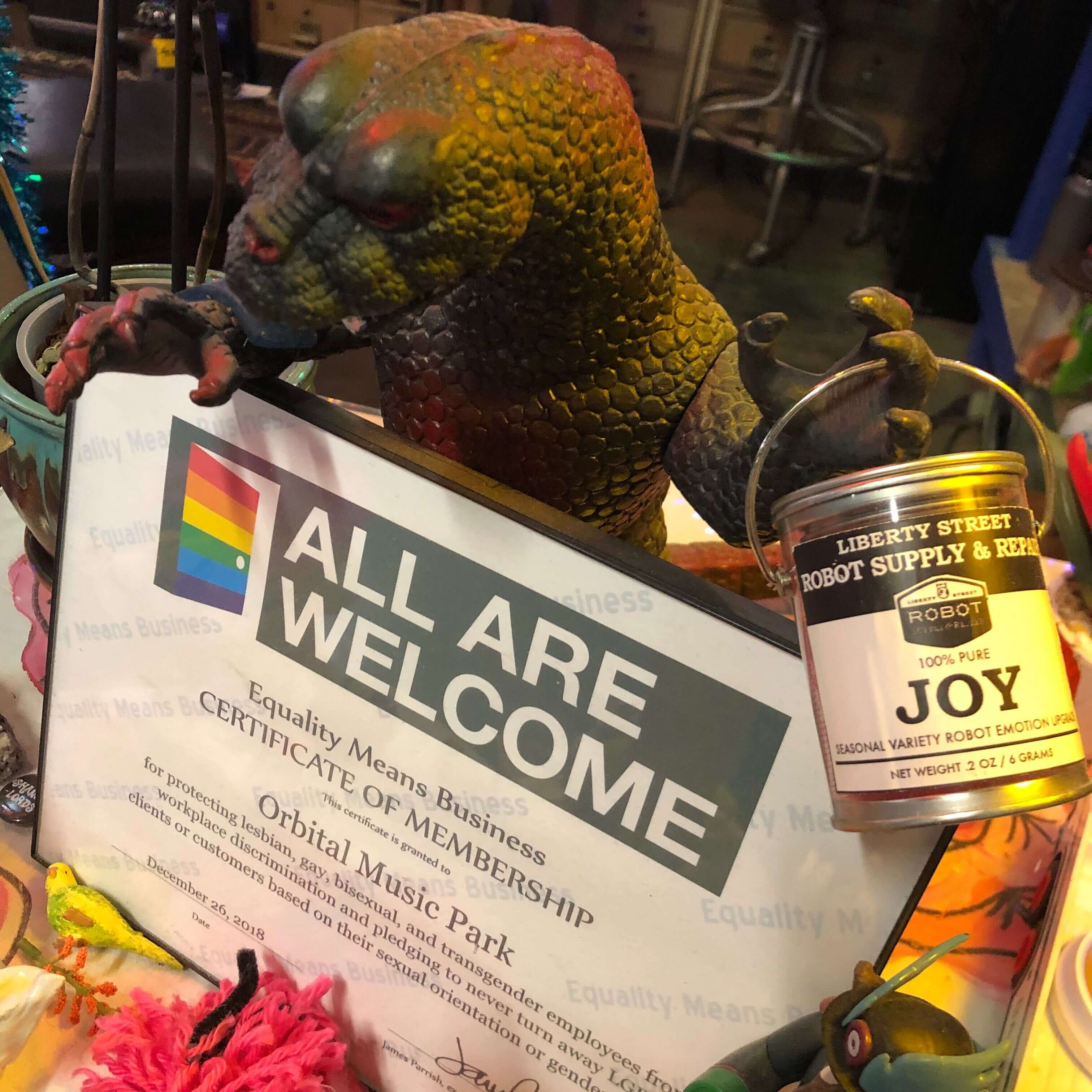 Plastic Godzilla proudly displays OMP's Equality Virginia certificate
