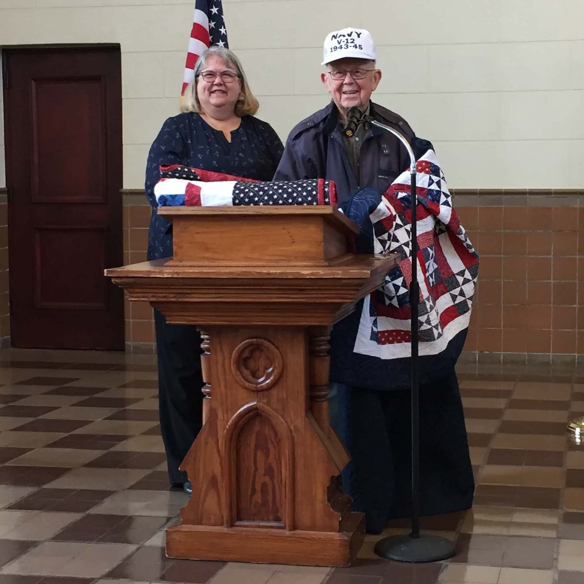 Ed Schwerdt receives Quilt of Valor from SDG employee Donna Rayson