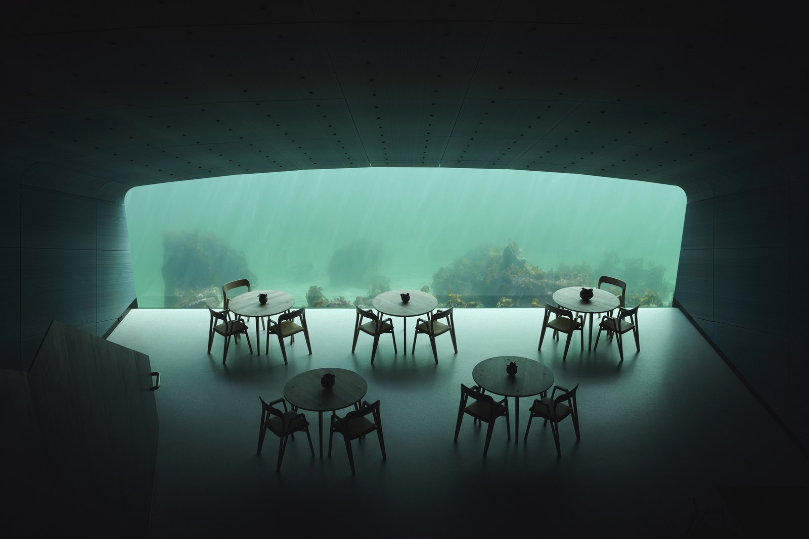 several tables with chairs around them