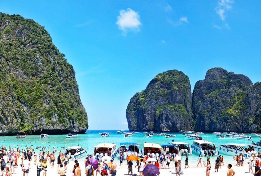 tourists and tour boats covering Maya Bay