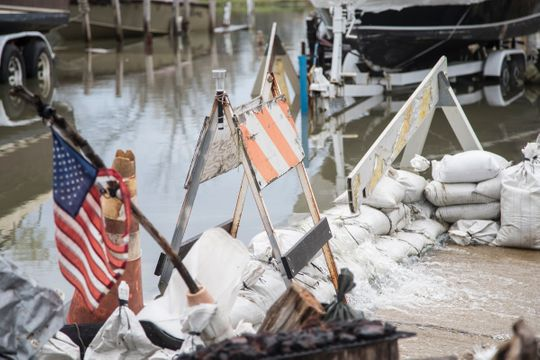 Sandbags have been laid in front of a house on Klenk Island in the Jefferson Chalmers neighborhood in Detroit to prevent water from flooding the houses across street, Wednesday, May 1, 2019.
