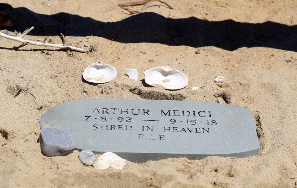 A memorial for Arthur Medici lays at the beach entrance. (Quincy Walters/WBUR)