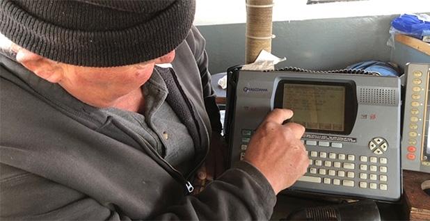 Fisherman Bobby Guzzo showing equipment he uses to monitor fish catches. Photo credit: Rob Hotakainen/E&E News