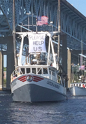 """Boat with message to President Trump saying """"Please help us."""" Photo credit: Mike Gambardella"""