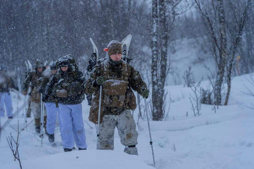Marines slog through a snowstorm.