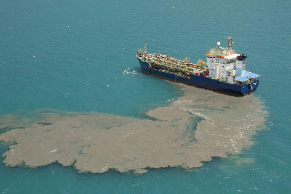 Plumes of sand from the Cairns Shipping Development Project, another dredging project currently under way off of Queensland, Australia.