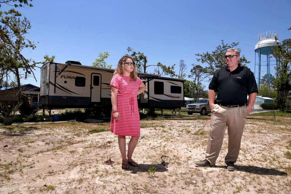 Marci Brannen, 34, left, and her fiancee Michael McKenzie, 43, stand in the location of their house prior to the landfall of Hurricane Michael. The home was deemed a total loss, which has prompted a battle between them and two insurance companies that hold their wind and flood policies. DOUGLAS R. CLIFFORD   Times