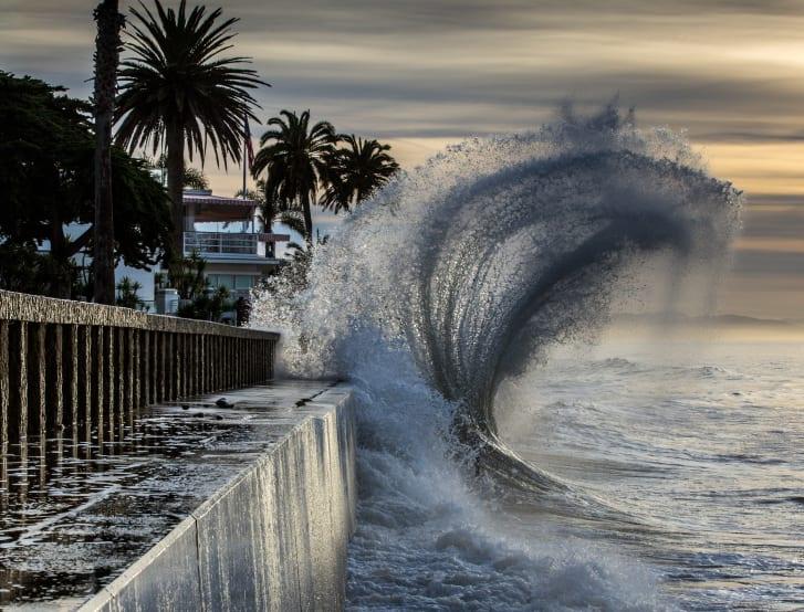 High tides batter the seawall at Butterfly Beach in Santa Barbara, California.