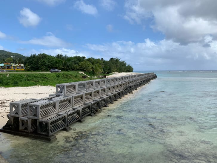 This seawall on the beach off Rarotonga, Cook Islands, uses fiber-reinforced concrete armour units to help dissipate wave energy while allowing water to pass through.