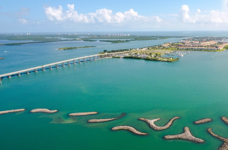 An aerial image of Fort Pierce Marina by local photographer Joseph Semkow. Designed by Tetra Tech, it includes a series of curved, artificial islands.