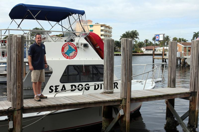 Pompano Dive Center's Bryan Armstrong with the Sea Dog Diver boat that ventures out to the SS Copenhagen shipwreck off Pompano Beach.