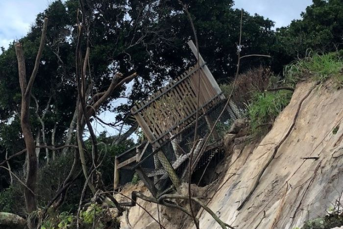 A viewing platform about to topple into the sea after severe erosion of sand dunes at Byron Bay's Clarkes Beach.