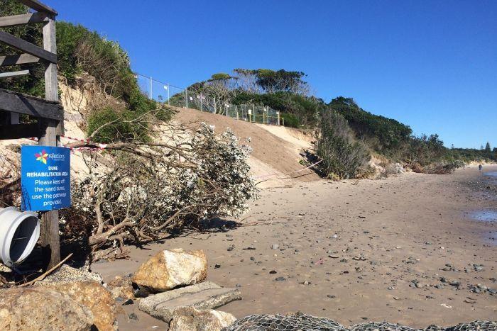Severe erosion of sand dunes at Byron Bay's Clarkes Beach.