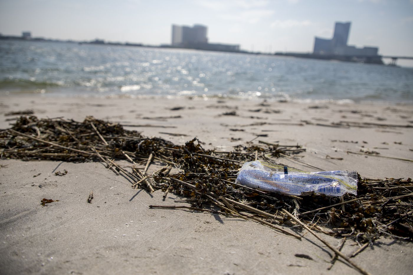 A piece of trash on the beach in Brigantine, N.J., on Wednesday, July 17, 2019. Locals are upset about how the beach is treated and clean up trash by bringing trash bags.