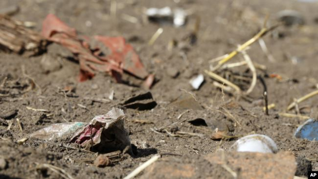 In this Sept. 9, 2018 photo, plastic waste sits on a freshly cultivated field in Nauen, Germany. (AP Photo/Ferdinand Ostrop)