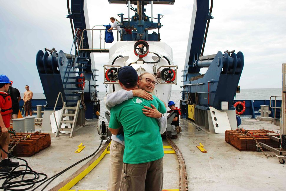 Samantha Joye and Erik Cordes hug after an Alvin dive to Pea Island seep.