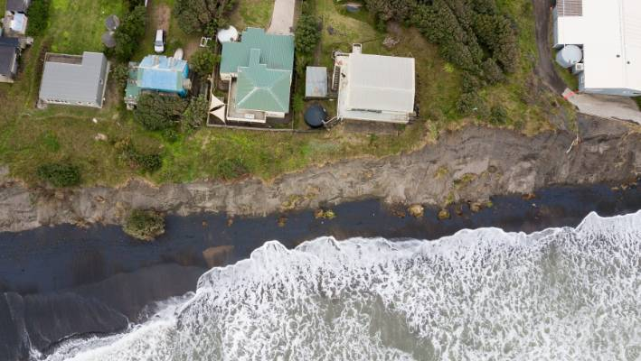 The view from above shows how close the erosion has come to the homes.