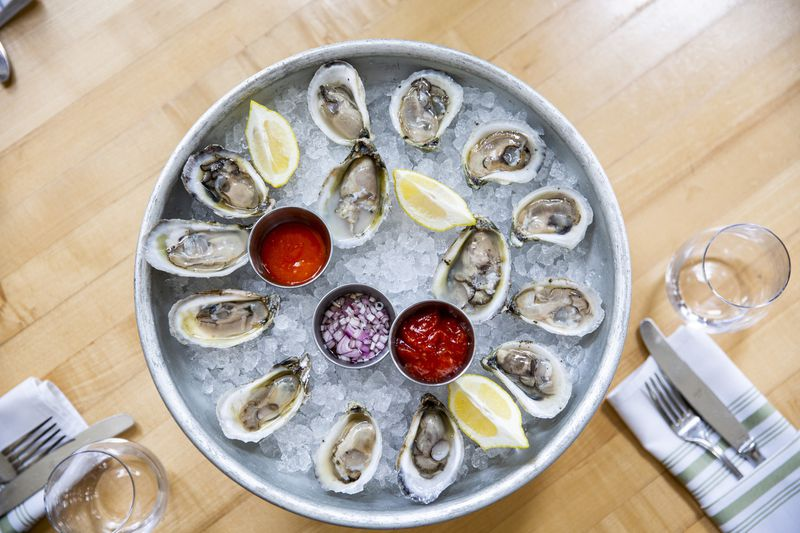 A selection of Florida oysters is presented on ice with sauces at The Osprey Tavern in Baldwin Park.