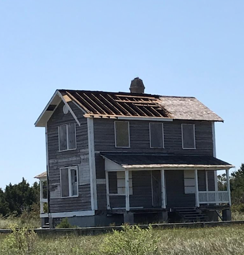 Built in 1907 as a lighthouse keeper's quarters and now known as the Barden House. Hurricane force winds removed not only the shingles but the underlying decking as well/NPS