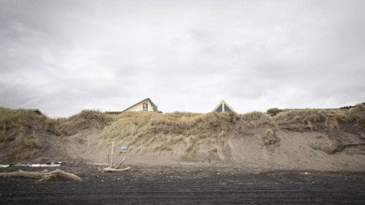 Jo Poland's house peeks out from the sand dunes. When she bought the section in 1994, she could only see the sea through rows and rows of dunes.