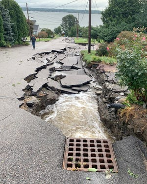 A road in Portsmouth, Rhode Island collapsed last month due to flooding after Hurricane Ida.