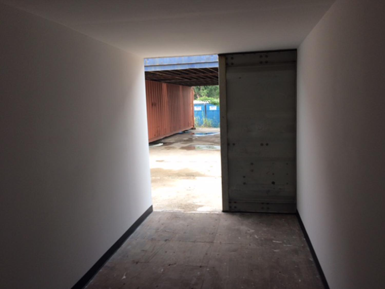 Shipping container drywall