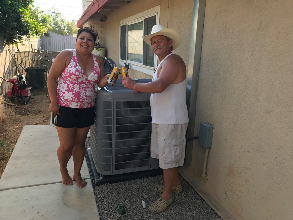 Happy customers with their newly installed air conditioning unit in Riverside, CA