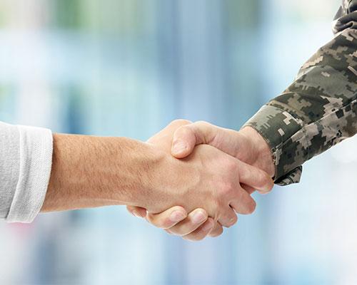 Veteran and civilian shaking hands