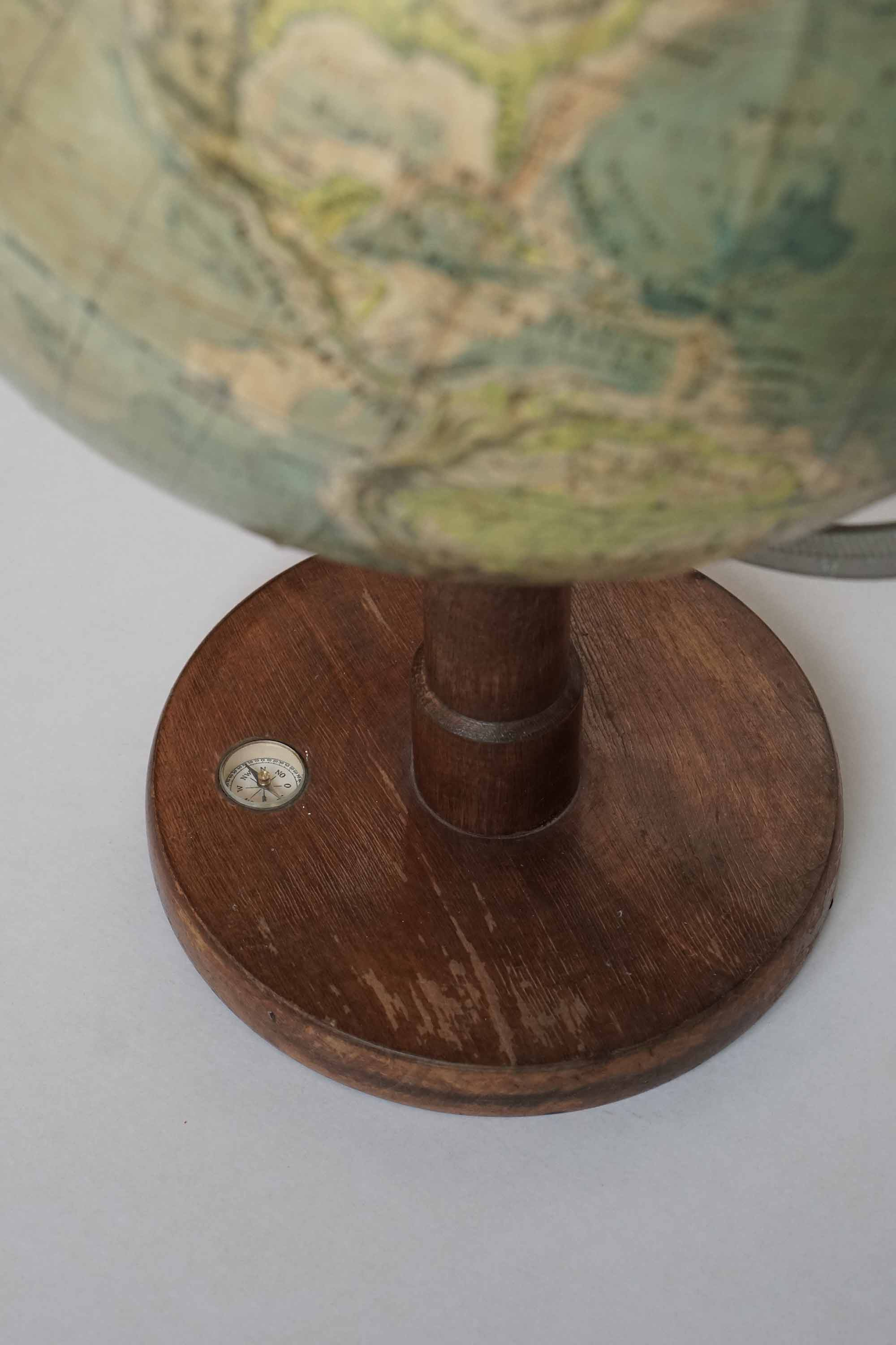 Uncommon WW2 physical world globe with compass in wooden base