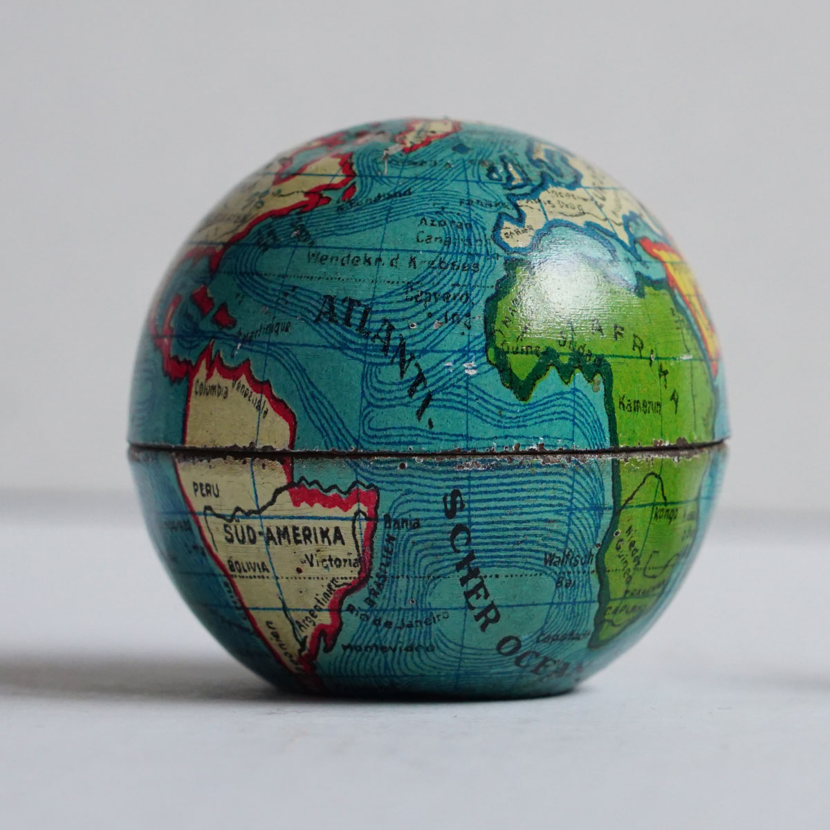 Tiny pencil sharpenner tin globe from late 19th century