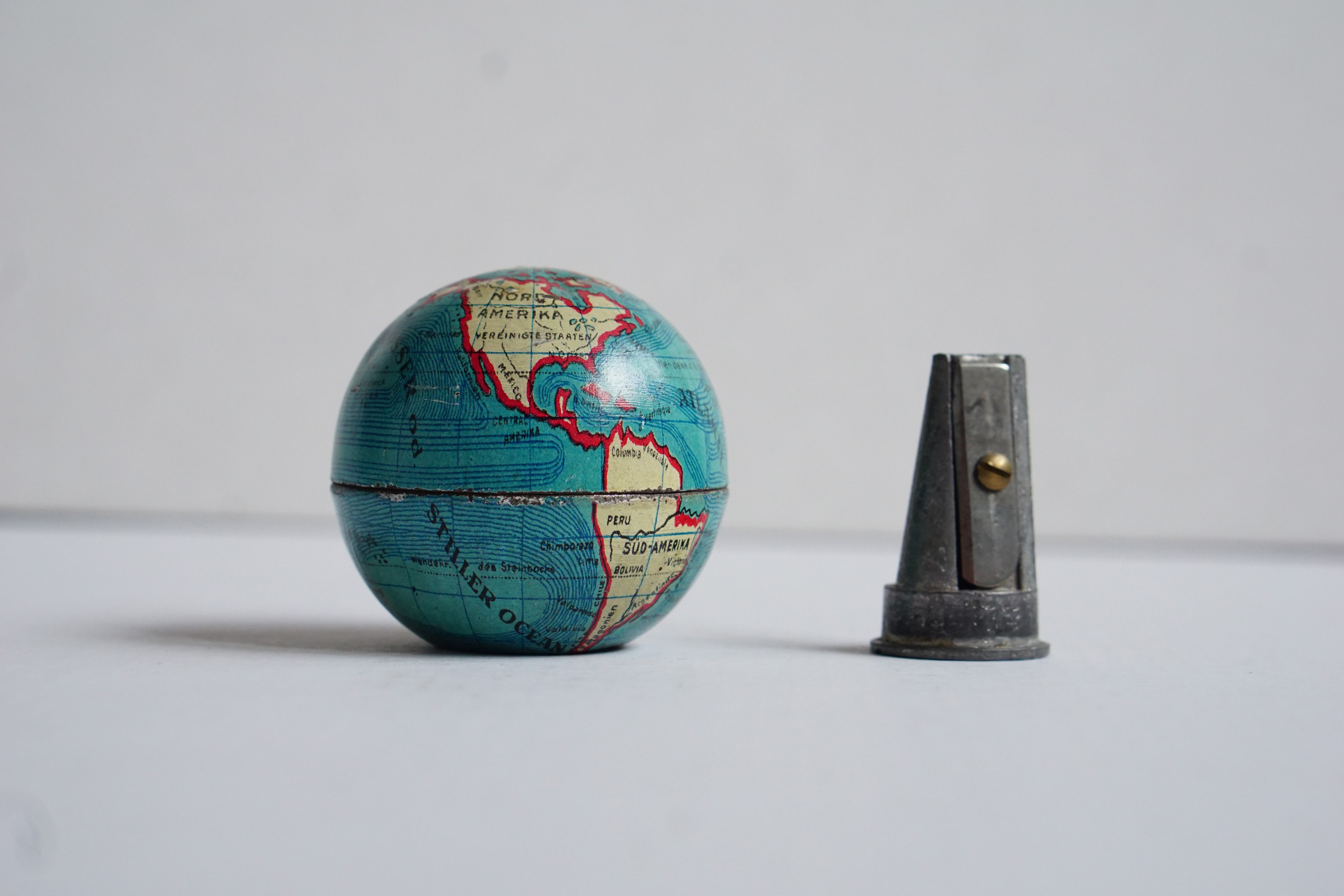 Small antique pencil sharpener tin globe