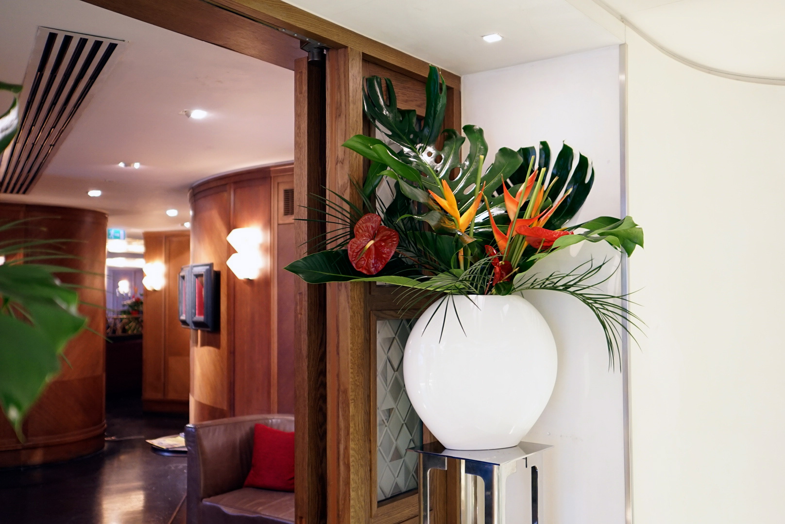 The Ivy Club Flowers - Winter Carnival - Monstera and Heliconia Flower Arrangement