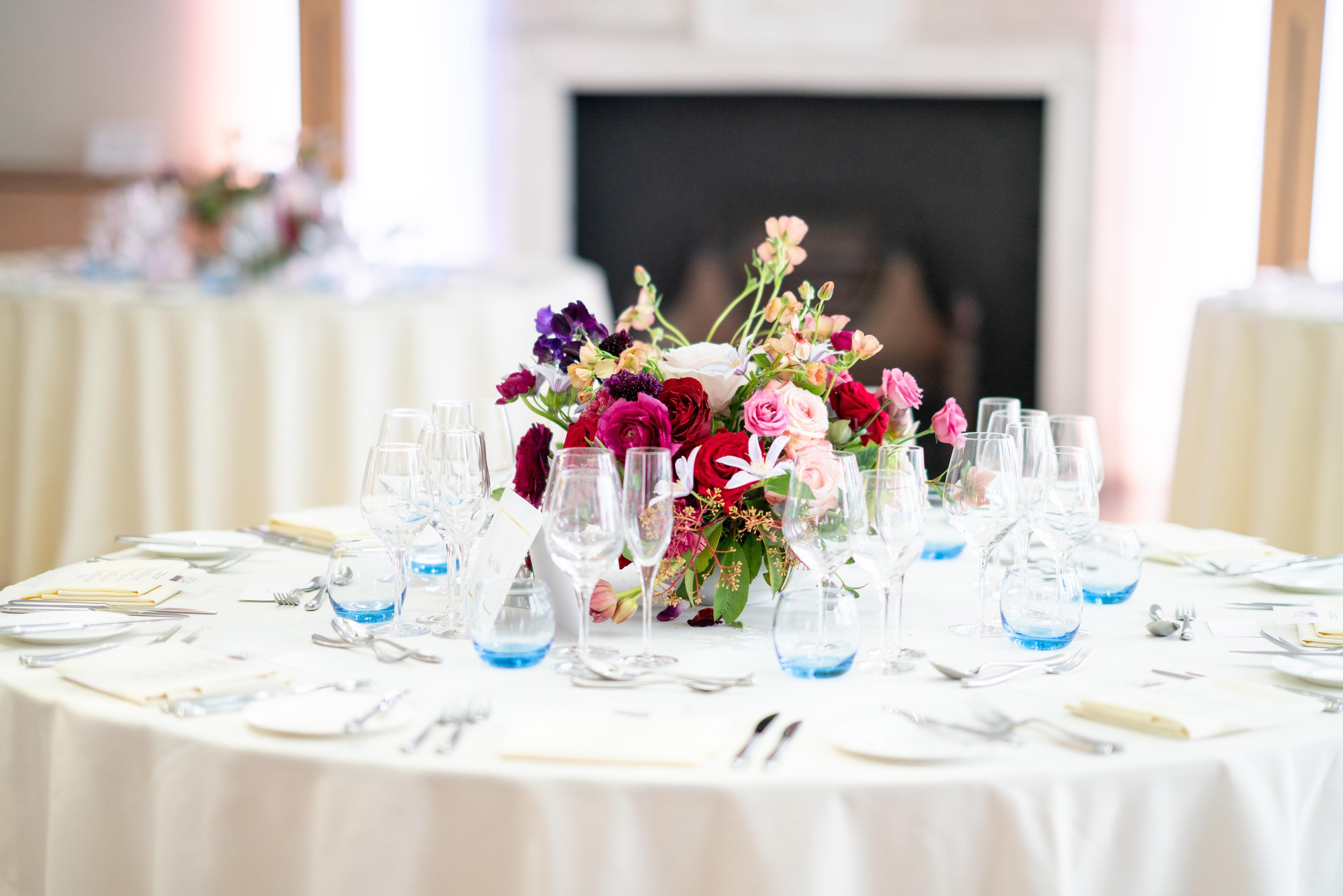 London Wedding Flowers with red roses, purple clematis, and unusual flower varieties
