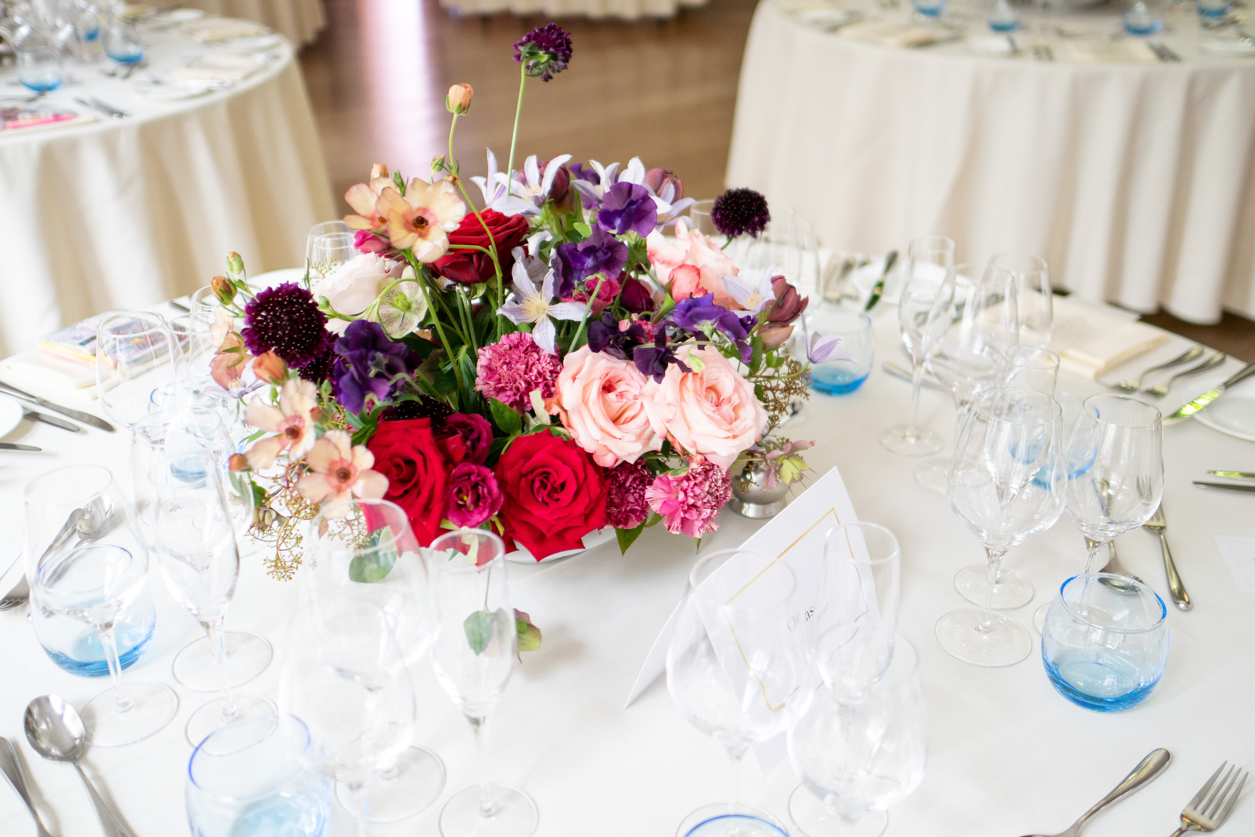 A modern interpretation on a classic centrepiece. Fragrant sweet peas, anemones, garden roses, scabiosas.
