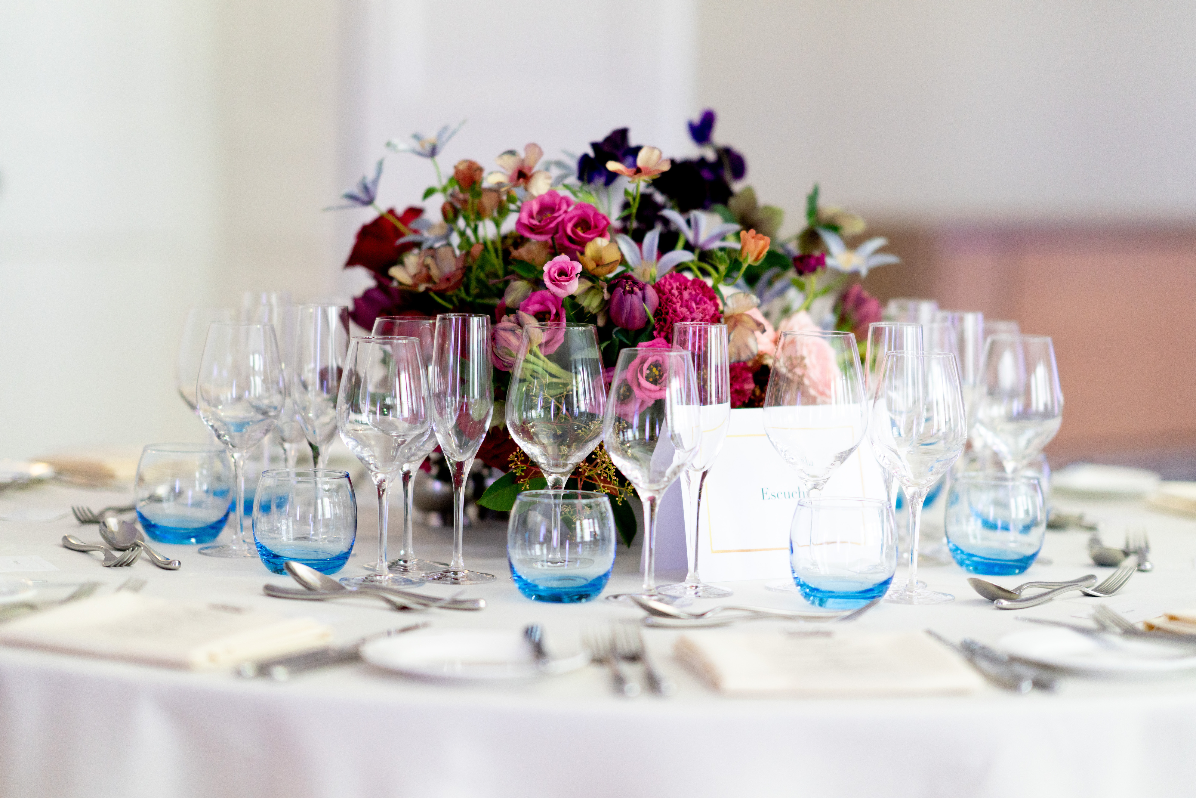 Full table set-up with a lovely flower centrepiece in the middle of the table