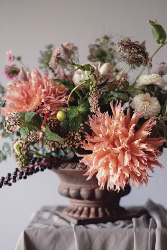 Autumn Orange and Mustard Dahlia Centrepiece in Rustic Brown Container