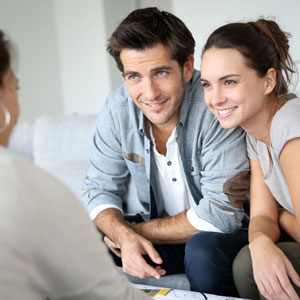 couple talking to approachable dentist