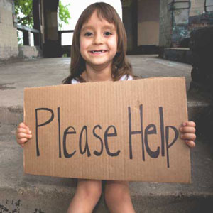 girl with a sign of 'please help'