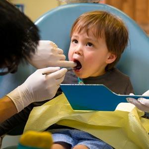 child being attended to by Hawthorn Dentist